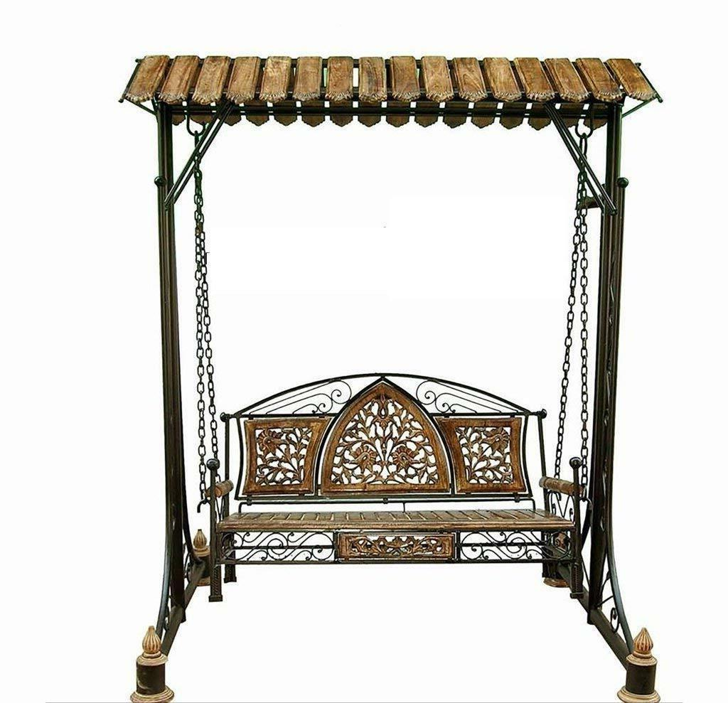 antique wooden and wrought iron swing